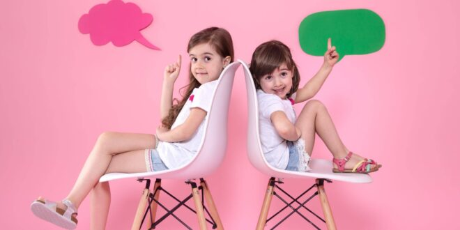 two little girls colored wall with speech icons scaled 1